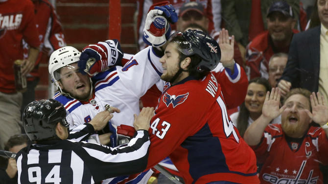 Linesman Bryan Pancich (94) works to separate New York Rangers center J.T. Miller, left, and Washington Capitals right wing Tom Wilson (43) during a scuffle in the first period of Game 4 in the second round of the NHL Stanley Cup hockey playoffs, Wednesday, May 6, 2015, in Washington. (AP Photo/Alex Brandon)