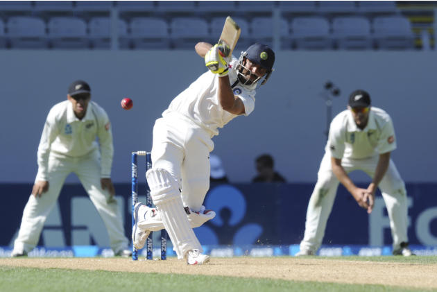 India's Ravindra Jadeja hits out to be caught by New Zealand's Ish Sodhi for 26 on the fourth day of the first cricket test at Eden Park in Auckland, New Zealand, Sunday, Feb. 9, 2014.(AP Photo/SNPA,