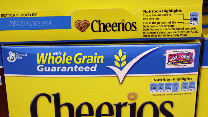 "Boxes of General Mill's ""Cheerios"" cereal are displayed at Piazza's grocery store in Palo Alto, Calif., Tuesday, June 28, 2011. General Mills Inc.'s fiscal fourth-quarter net income rose 51 percent on stronger sales but was hampered by higher ingredient costs. (AP Photo/Paul Sakuma)"