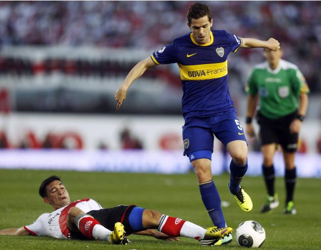 Boca Juniors' Gago is challenged by River Plate's Rojas during their Argentine First Division soccer match in Buenos Aires