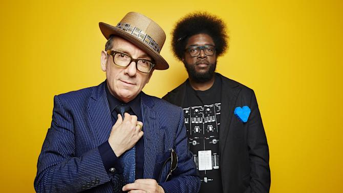"""From left, English singer-songwriter Elvis Costello poses for a portrait with drummer Ahmir """"Questlove"""" Thompson of """"The Roots,"""" in promotion of their upcoming album """"Wise Up Ghost,"""" Tuesday, May 21, 2013, in New York. (Photo by Dan Hallman/Invision/AP)"""
