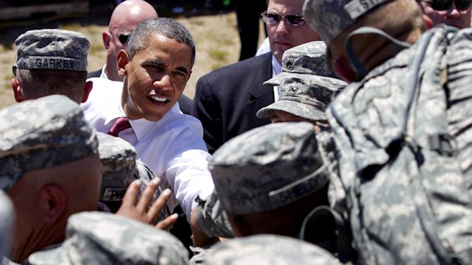 President Barack Obama reaches to shake hands with troops after speaking at the Third Infantry Division Headquarters, Friday, April 27, 2012, at Fort Stewart, Ga. (AP Photo/Carolyn Kaster)