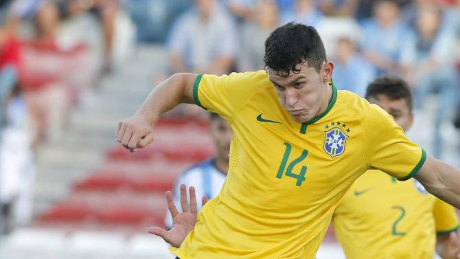 Argentina's Giovanni Simeone (L) competes for the ball with Brazil's Nathan C during their match for the final round of the South American Under-20 Championship in Montevideo