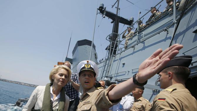 German Defence Minister Ursula von der Leyen is welcomed aboard the German navy vessel Schleswig Holstein by ships captain Marc Metzger off coast Catania