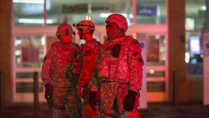 National Guard troops guard a Walgreens store from protesters during a second night of protests in Ferguson, Missouri
