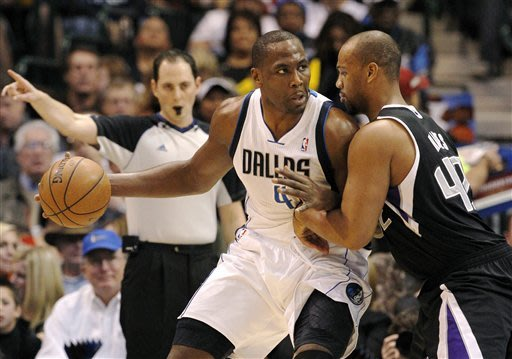 Dallas Mavericks' Elton Brand (42) looks for an opening against Sacramento Kings' Chuck Hayes, right, in the first half of an NBA basketball game Monday, Dec. 10, 2012, in Dallas. (AP Photo/Tony Gutierrez)