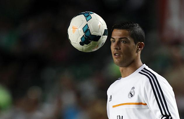 Real Madrid's Cristiano Ronaldo from Portugal  before their La Liga soccer match against Elche at the Martinez Valero stadium in Elche, Spain, Wednesday, Sept. 25, 2013