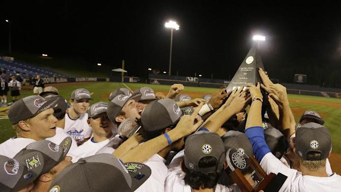 Florida players gather with the championship trophy after winning against Vanderbilt in the Southeastern Conference NCAA college baseball tournament championship game at the Hoover Met, Sunday, May 24, 2015, in Hoover, Ala. Florida won 7-3.  (AP Photo/Butch Dill)