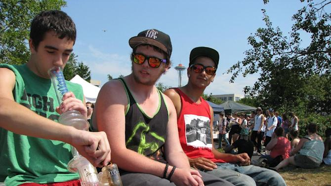 Matt Galanti, 17, of Bothell, Wash., smokes marijuana from a glass bong at the opening day of the pro-marijuana rally Seattle Hempfest, Aug. 17, 2012, as friends Zach Casselman, 18, of Bothell, and Clay Graeber, 20, of Bothell, look on. Organizers expected more than 150,000 people to attend the three-day event, which comes as citizens in Washington state prepare to vote on an initiative that would legalize and tax the sale of up to an ounce of cannabis at state-licensed stores. (AP Photo/Gene Johnson)