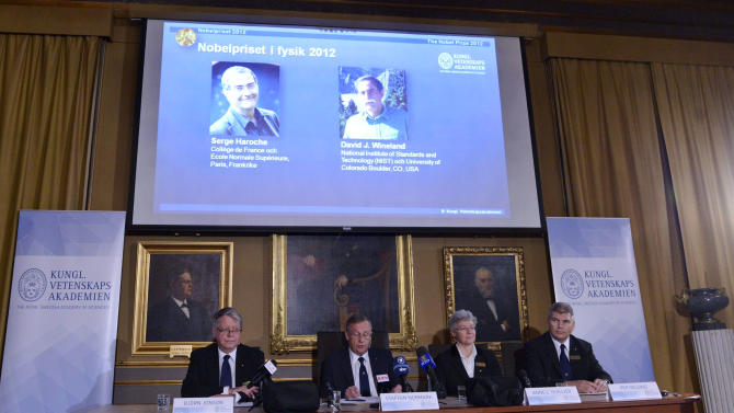 """Photographs of the 2012 Nobel Prize laureates in Physics Serge Haroche from France, left, and David Wineland from the US are presented on a screen during a media conference at the Royal Swedish Academy of Science in Stockholm, Sweden, Tuesday Oct. 9, 2012.  Frenchman Serge Haroche and American David Wineland have won the 2012 Nobel Prize in physics for inventing and developing methods for observing tiny quantum particles without destroying them. The Royal Swedish Academy of Sciences cited the two scientists Tuesday """"for ground-breaking experimental methods that enable measuring and manipulation of individual quantum systems.""""   (AP Photo / Bertil Enevag Ericson / SCANPIX)    SWEDEN OUT"""