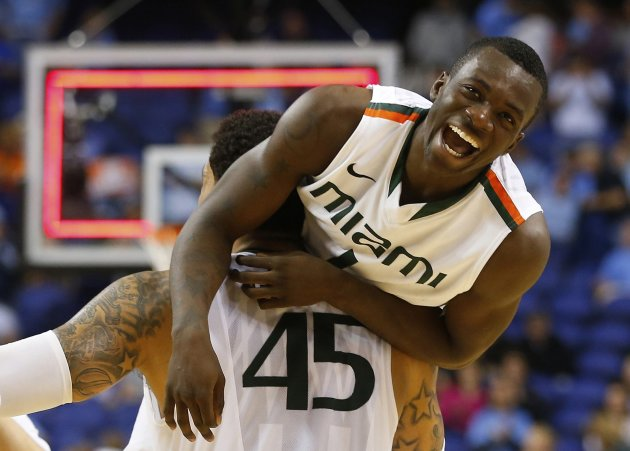 Miami Hurricanes forward/center Julian Gamble holds teammate guard Durand Scott into the air after they defeated the North Carolina Tar Heels in the ACC Championship college basketball game in Greensb