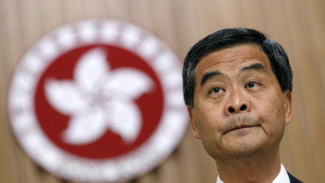 """Hong Kong Chief Executive Leung Chun-ying attends a news conference at the government headquarters in Hong Kong, Friday, Sept. 7, 2012. Leung said he is willing to have an open dialogue with opponents of national education. Protesters urged the government to cancel new additional course, """"Moral and National Education"""" subject, to be introduced for school curriculum, starting from a new school year. (AP Photo/Kin Cheung)"""