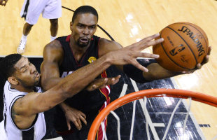Chris Bosh was too much for Tim Duncan and the Spurs to handle Sunday night. (AP)