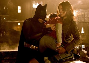 Christian Bale as Batman and Katie Holmes as Rachel Dawes in Warner Bros. Pictures' Batman Begins