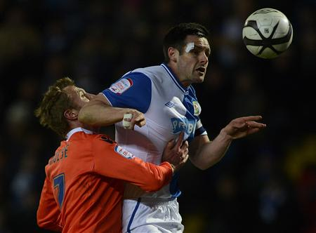Millwall's Hulse challenges Blackburn Rovers' Dann during their English FA Cup quarter-final soccer match in Blackburn