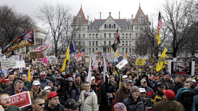Gun rights advocates demonstrate outside the Capitol on Thursday, Feb. 28, 2013, in Albany, N.Y. Thousands of opponents rallied against the recently legislated NY SAFE Act and other measures they say infringe on their constitutional right to bear arms. (AP Photo/Mike Groll)