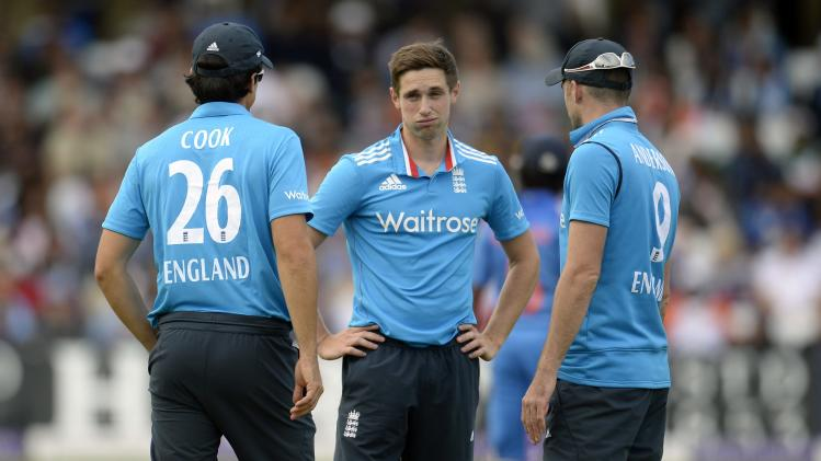 England's Woakes talks to Cook and Anderson during the third one-day international cricket match against India at Trent Bridge cricket ground in Nottingham, England August 30, 2014.
