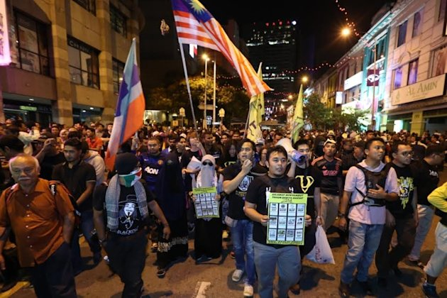 Protesters started gathering at 9pm at several locations around Kuala Lumpur before making their way towards Dataran Merdeka. — Picture by Saw Siow Feng