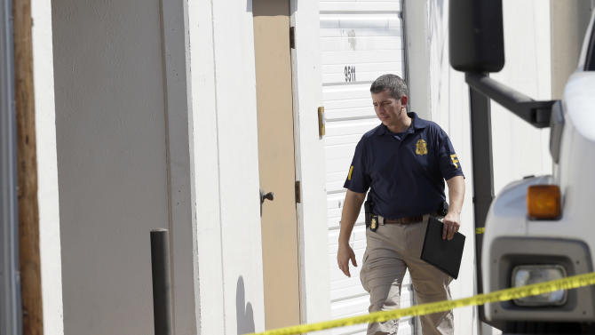 An FBI agent enters Arc Electronics Inc. Wednesday, Oct. 3, 2012 in Houston. A Kazakhstan-born businessman was charged in the U.S. on Wednesday with being a secret Russian agent involved in a scheme to illegally export microelectronics from the United States to Russian military and intelligence agencies. (AP Photo/David J. Phillip)