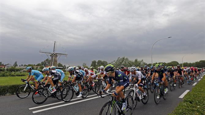 The pack of the riders cycle during the 166-km (103.15 miles) second stage of the 102nd Tour de France cycling race from Utrecht to Zeeland