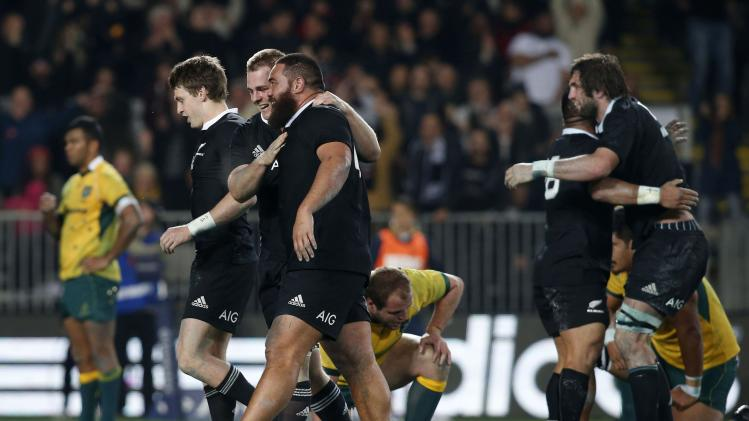 New Zealand's All Blacks celebrate a last minute try while defeating the Australia's Wallabies during their second Bledisloe Cup rugby championship match at Eden Park in Auckland