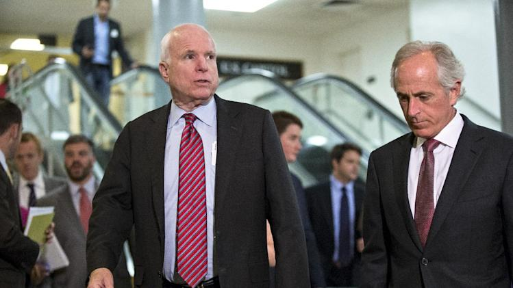 Sen. John McCain, R-Ariz., left, and Sen. Bob Corker, R-Tenn., right, members of the Senate Foreign Relations Committee, walk to a closed-door briefing on Syria with Secretary of State John Kerry, at the Capitol in Washington, Tuesday, Sept. 17, 2013. Kerry is back from last week's negotiations in Geneva and is updating the senators on the chemical weapons plan ironed out with Russia. (AP Photo/J. Scott Applewhite)