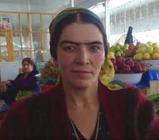 A woman with a unibrow in Tajikistan, where they are considered a symbol of beauty. Photo via Global Post.