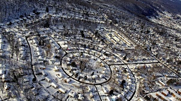 A Southwestern, Connecticut neighborhood is blanketed in snow Sunday, Feb. 10, 2013, in the aftermath of a storm that hit Connecticut and much of the New England states. (AP Photo/Craig Ruttle)