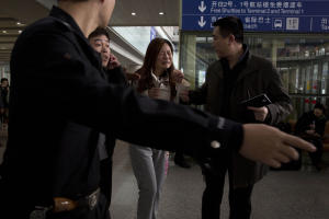 A woman cries at the arrival hall of the International…