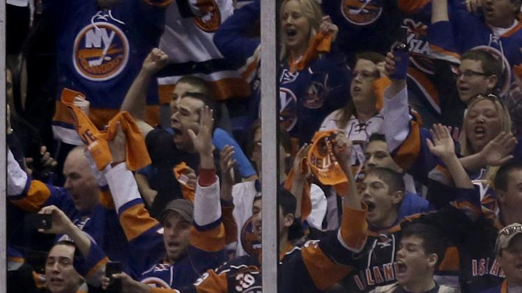 New York Islanders' Matt Moulson reacts after scoring during the first period of Game 3 of an NHL hockey Stanley Cup first-round playoff series against the Pittsburgh Penguins, Sunday, May 5, 2013, in Uniondale, N.Y. (AP Photo/Seth Wenig)