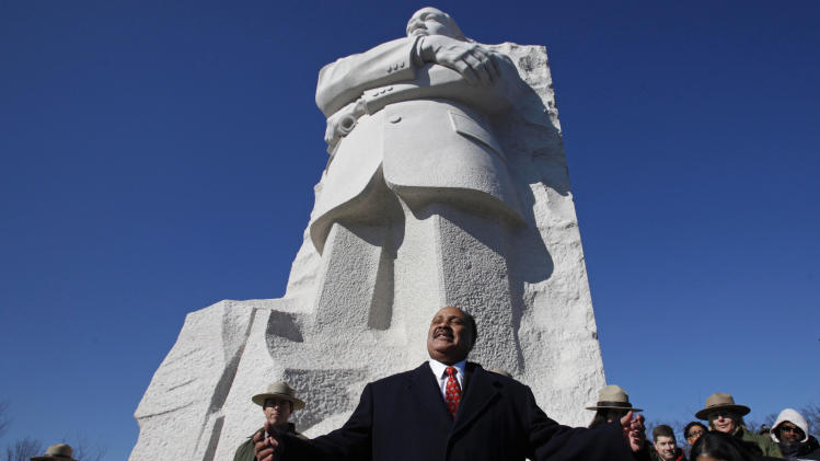 """FILE - In this Sunday, Jan. 15, 2012 file photo, Martin Luther King III, center, the son of civil rights leader Martin Luther King Jr., speaks during a ceremony at the Martin Luther King Jr. Memorial, in Washington, in observance of the slain civil rights leader's 83rd birthday anniversary. Martin Luther King III believes that one day we will be able to live every word of his father's dream. """"I think my father's vision was that we should at some point have a colorblind society,"""" he says. """"He always was challenging us to be the best nation we could be."""" (AP Photo/Jacquelyn Martin, File)"""