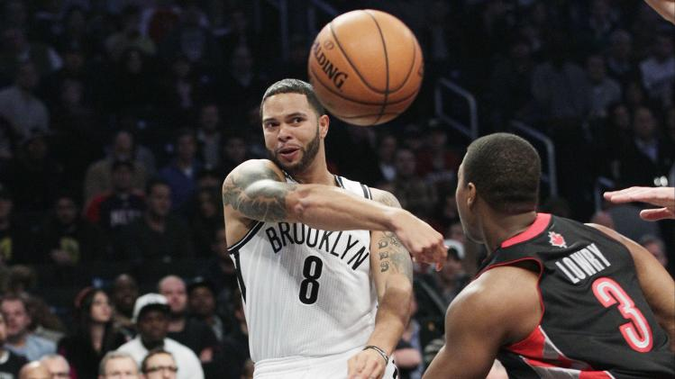 Brooklyn Nets' Deron Williams (8) passes away from Toronto Raptors' Kyle Lowry (3) during the first half of an NBA basketball game, Saturday, Nov. 3, 2012, in New York. (AP Photo/Frank Franklin II)
