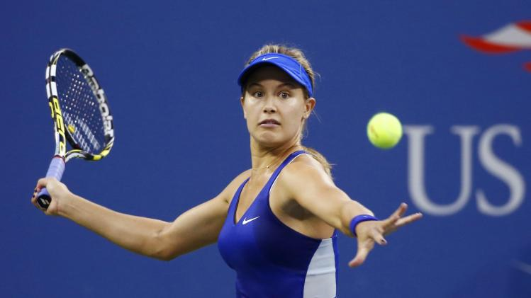 Eugenie Bouchard of Canada returns a shot to Barbora Zahlavova Strycova of the Czech Republic in their women's singles match at the 2014 U.S. Open tennis tournament in New York