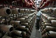 An Indian employee checks reels of thread at a factory in Jammu in July 2012. India&#39;s industrial production contracted by a shock 1.8 percent from a year earlier in June, as manufacturing output shrank in Asia&#39;s third-largest economy, official figures showed on Thursday
