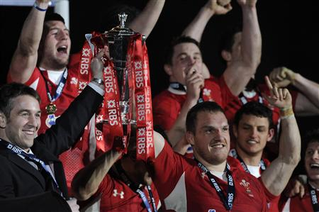 Wales' captain Gethin Jenkins poses with the Six Nations Trophy after defeating Englandduring their Six Nations international rugby union match at the Millennium Stadium in Cardiff