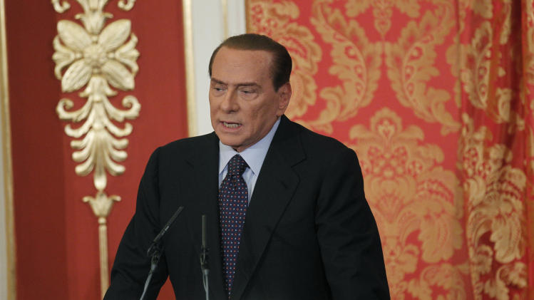 Former Italian Premier Silvio Berlusconi talks during a press conference in Gerno, near Milan, Saturday, Oct. 27, 2012. Silvio Berlusconi, who announced this week he wouldn't run in spring elections, pulled an about-face Saturday and said he felt compelled to stay in politics to reform Italy's justice system after being convicted of tax fraud. (AP Photo/Luca Bruno)