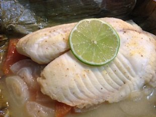Tilapia cooked in plantain leaf
