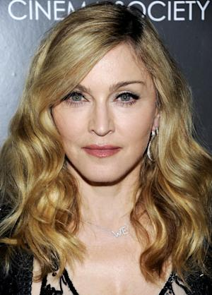 "FILE - In this Dec. 4, 2011 file photo, director Madonna attends a special screening of ""W.E."" at the Museum of Modern Art in New York. Madonna will release a new album in late March through Universal Music Group's Interscope Records, the label said Thursday, Dec. 15. (AP Photo/Evan Agostini, file)"