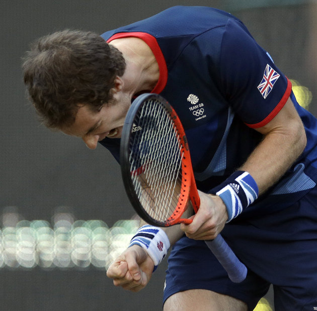 Andy Murray of Great Britain celebrates after winning the first set against Novak Djokovic of Serbia at the All England Lawn Tennis Club in Wimbledon, London at the 2012 Summer Olympics, Friday, Aug.