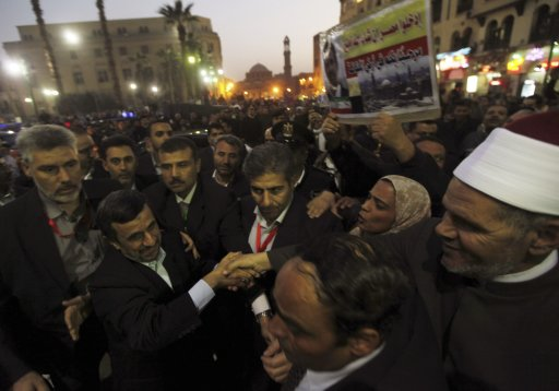 Iran's President Mahmoud Ahmadinejad shakes hands a sheikh as he arrives in front of the Al-Hussein mosque in old Cairo