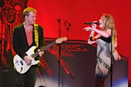 Musician Kenny Wayne Sheperd, left, and singer Leann Rimes perform at &quot;Play It Forward: A Celebration of Music&#39;s Evolution and Influencers&quot; at the Grammy Foundation&#39;s 15th Annual Music Preservation Project, Thursday, Feb. 7, 2013, in Los Angeles. (Photo by Vince Bucci/Invision/AP)