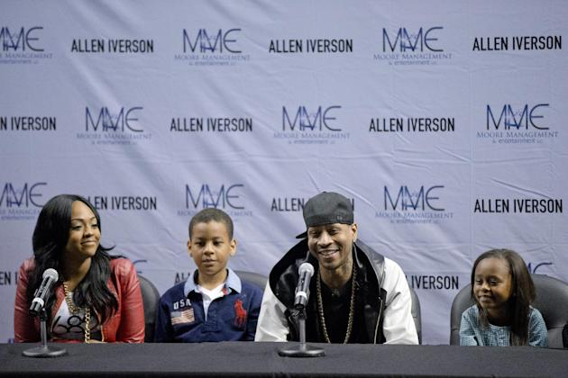 Former Philadelphia 76er Allen Iverson, accompanied by his daughter Tiaura, 18, left, son Isaiah, 7, second from left and daughter Messiah, 10, right, speaks at a news conference Wednesday, Oct. 30, 2