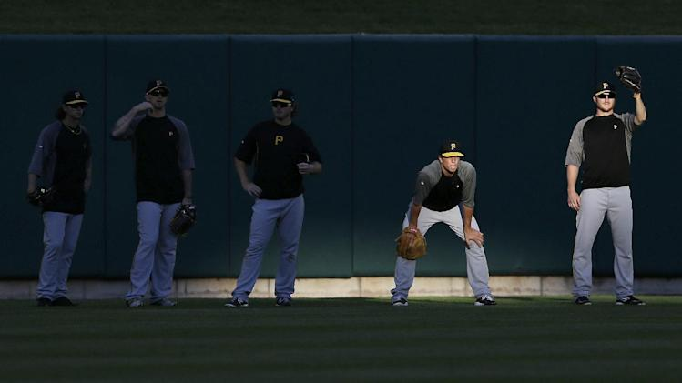Pittsburgh Pirates watch for fly balls during batting practice before Game 5 of a National League baseball division series between the Pirates and the St. Louis Cardinals on Wednesday, Oct. 9, 2013, in St. Louis