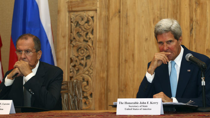 "U.S. Secretary of State John Kerry and Russian Foreign Minister Sergey Lavrov listen to a question by a journalist during a joint press conference on the sidelines of the Asia-Pacific Economic Cooperation (APEC) summit in Bali, Indonesia, Monday, Oct. 7, 2013. Kerry said that the United States and Russia are ""very pleased"" with the progress made so far in destroying Syria's chemical weapons stocks. (AP Photo/Firdia Lisnawati)"
