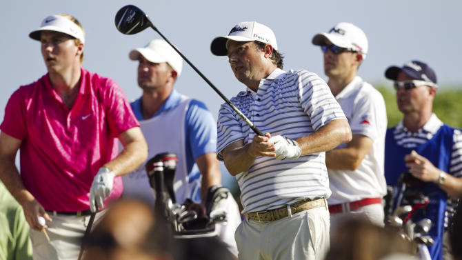 Tim Clark, center, of South Africa, follows his shot off the 14th tee as playing partners Russell Henley, left, and Scott Langley, second from right, watch during the final round of the Sony Open golf tournament, Sunday, Jan. 13, 2013, in Honolulu. (AP Photo/Marco Garcia)