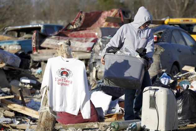 "Sweatshirt proclaiming ""I can't take it anymore"" hangs amid the debris of homes where several people died in tornado destruction in East Bernstadt, Kentucky"