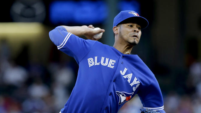 Toronto Blue Jays starting pitcher Esmil Rogers throws during the first inning of a baseball game against the Texas Rangers, Thursday, June 13, 2013, in Arlington, Texas. (AP Photo/LM Otero)