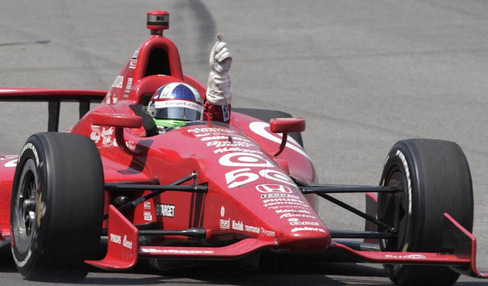 Dario Franchitti, of Scotland, reacts after winning IndyCar's Indianapolis 500 auto race at Indianapolis Motor Speedway in Indianapolis, Sunday, May 27, 2012. (AP Photo/AJ Mast)