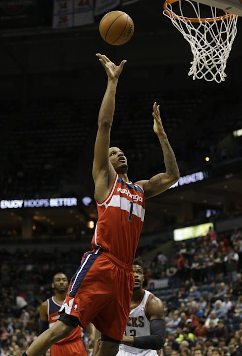Washinton Wizards' Trevor Ariza shoots against the Milwaukee Bucks during the first half of an NBA basketball game on Saturday, March 8, 2014, in Milwaukee. (AP Photo/Jeffrey Phelps)