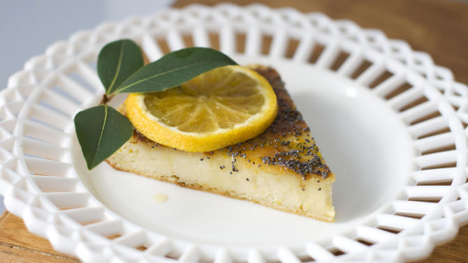 n this image taken on November 5, 2012, a slice of Roman cheesecake with orange-scented honey is shown served on a plate in Concord, N.H. (AP Photo/Matthew Mead)
